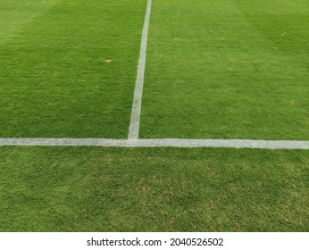 Line on Soccer field or football field texture background. White lines on green synthetic grass.
