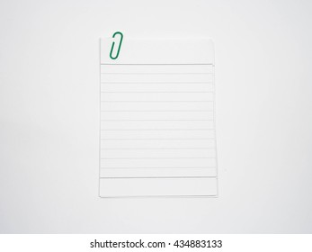 Line paper note with clip. Blank paper note