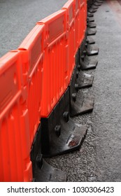 A line of plastic safety barrier on a road works site