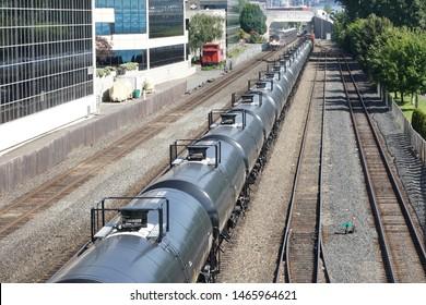 A line of railroad train tanker cars