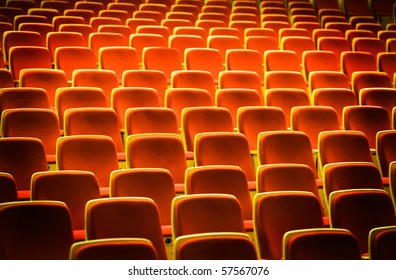 A line of red theater chairs.