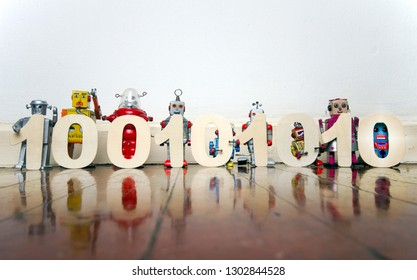 a line of retro bots on a wooden floor with 0,s and 1,s binary code numers