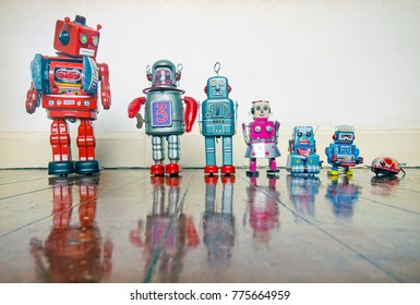 a line of retro robots on a wooden floor with reflection,