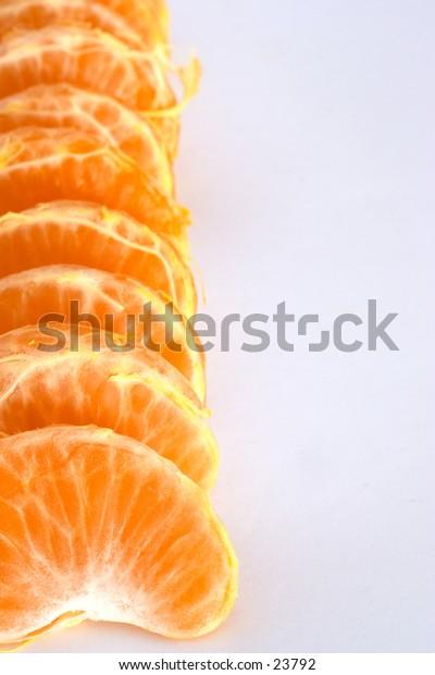 A line of satsuma, clementine or mandarin segments.