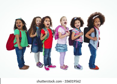 Line of schoolkids with bags against a white background