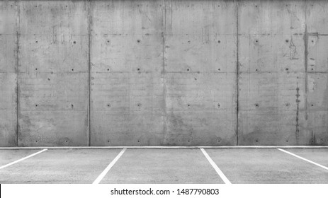 Line of several empty parking lots in an open garage with concrete wall - Shutterstock ID 1487790803