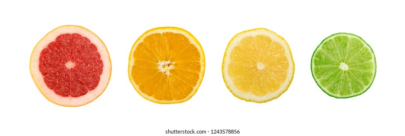 Line of sliced lemon, orange, lime and red grapefruit flat lay and top view. Macro photo of citrus fruits isolated on white background
