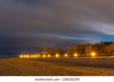 Line of the street lights on the sea beach at night. Long exposure