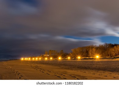 Line of the street lights on the sea beach at night