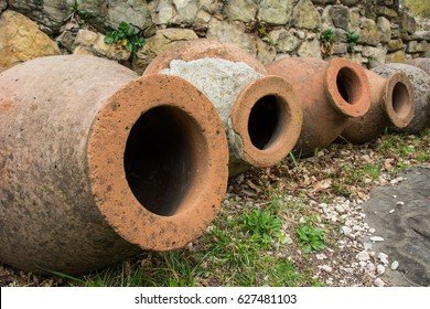 A line of terra cotta kvevri, traditional clay pots used by Georgians which were filled with grapes and buried in the ground to make wine, by a monastery in Telavi, Georgia