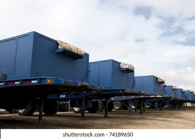 Line of trailers at agricultural packing plant used to haul potatoes