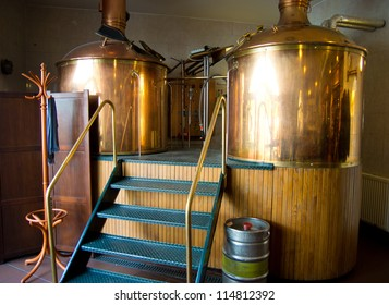 Line of two traditional brewing vessels in brewery.