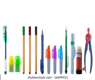 A line of varied and colorful school supplies. Isolated on white.
