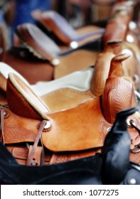Line of Western Saddles for Sale (shallow focus).