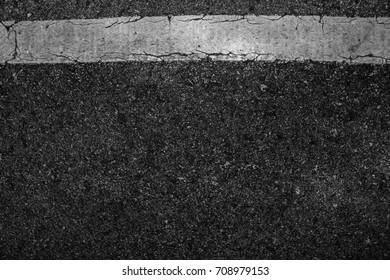 Line white old on asphalt black texture background.
