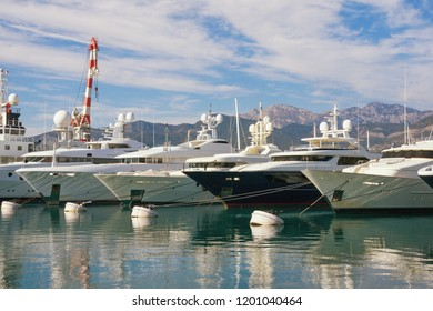 Line of yachts in port. Montenegro, Adriatic Sea, Bay of Kotor. View of  marina of Porto Montenegro in Tivat city
