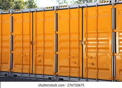 A line of yellow and grey metal storage containers