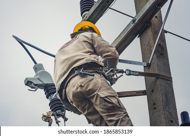 Lineman climb concrete pole and use clamp stick grip all types to connect the single phase transformer to the distribution system.