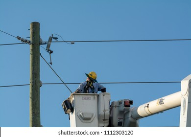 A lineman makes upgrades to restore power after an outage on June 13, 2018 on Bowman Road in Spring Hill Florida USA