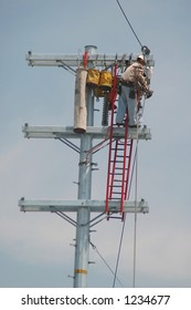 Lineman working on high voltage pole