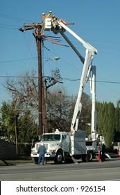 Linemen replacing conduit on 12 kV circuit