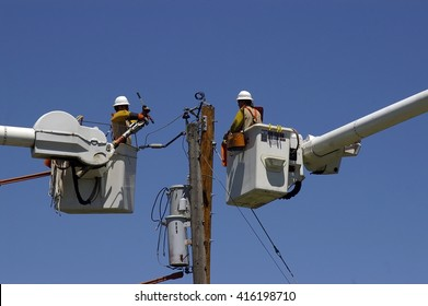 Linemen replacing old utility pole