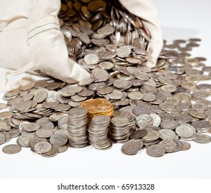 Linen bag of old pure silver coins used to invest in silver as a commodity with a selection of Golden Eagle gold coins