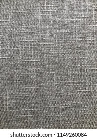 Linen cloth in beige tones with structure, as background.