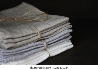 Linen cloth napkins in brown and beige natural colors folded and tied with string