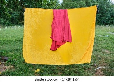 linen is dried on a rope in the village