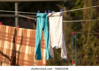 linen dries on a rope in the open air .