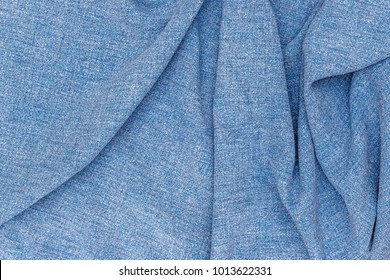 Linen fabric denim blue background. Wrinkled Linen blue fabric texture. Stone washed blue pure linen tablecloth background