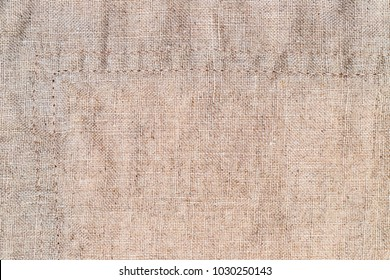 Linen fabric with double seam.  Stone washed pure linen texture. Wrinkled linen fabric background. Natural linen texture with double side seam