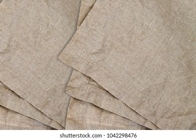 Linen fabric with double seam.  Stone washed pure linen texture. Wrinkled linen fabric background. Natural linen texture with double seam