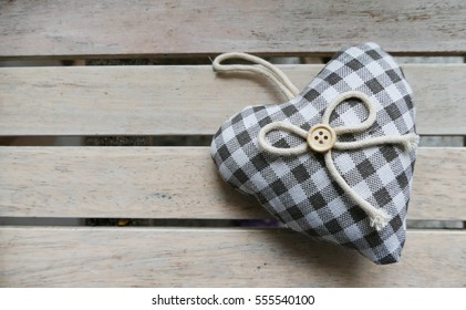 Linen heart on the wooden table
