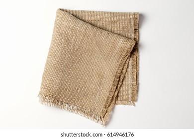 Linen napkin on white background. Top view