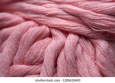 linen pink rope texture. thread in clew close up