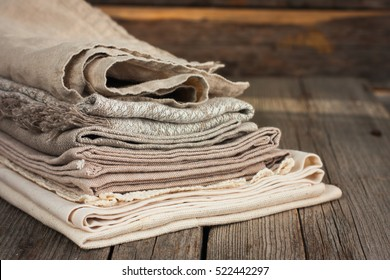 Linen tea towels beige on a wooden table, Horizontal, copy space