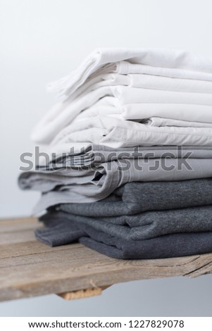 0d40e5bdef4 linen textile in stacked pile. sheet and cover. different shades white grey  pastel color