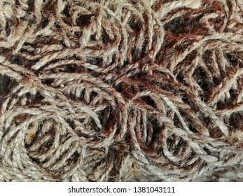 Linen yarn rope & thread texture background. Flax fibers for production of linen fabrics, linen yarn & thread pattern. Twisted raw hemp or cotton yarn, thread, rope - grunge curve material wallpaper
