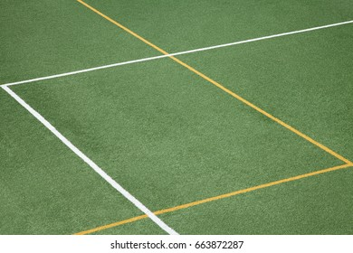 Lines and angles on green sports ground. Green background