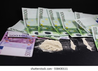Lines of Cocaine with money on a black background. Say no to drugs.