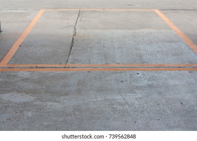 Lines of color on the concrete floor show the line.