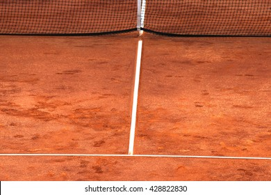 Lines and net on a red clay's tennis court