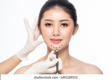 Lines on face, close up, plastic surgery concept, doctor's hand in glove making marks on patient's face.Asian beauty  Woman in beauty salon. plastic surgery clinic.