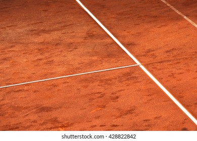 Lines on a red clay's tennis court