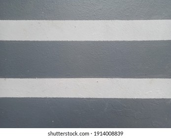 Lines on the sidewalk with white and gray background
