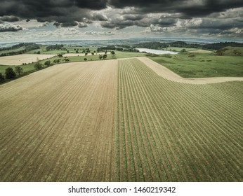 Lines over a field with clouds