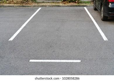 Lines parking on asphalt background