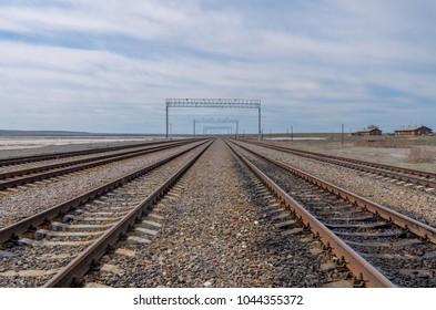 lines of railroad tracks disappear over horizon Baskunchak, Astrakhan region